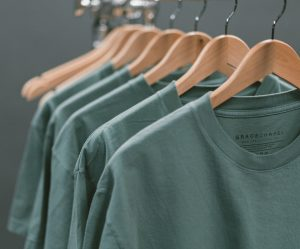 a rack of t-shirts